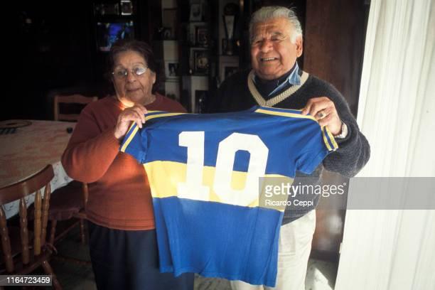 Parents of Diego Armando Maradona Dalma Salvadora Franco and Diego Maradona Senior hold the number 10 first teamjersey of Boca Jrs from their son...