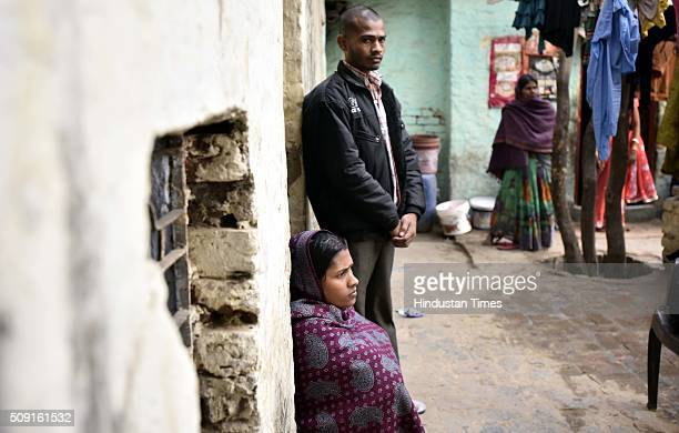 Parents of fiveyearold boy Ankit Kumar who died after falling into an open septic tank in his school at Kapashera on February 9 2016 in New Delhi...