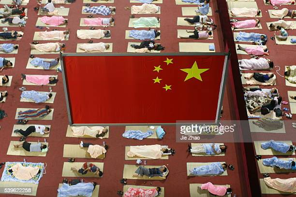 Parents of freshmen sleep on mats laid out on the floor of a gymnasium inside an university campus in Wuhan Hubei province September 7 2009 The...