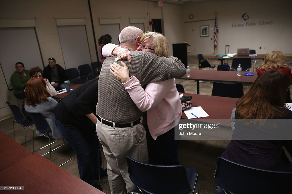 Parents of heroin and opioid addicts embrace during a family addiction support group on March 23, 2016 in Groton, CT. The group Communities Speak Out organizes monthly meetings at a public library for family members to talk about how their loved ones' addiction affects them and to give each other emotional support. Communities nationwide are struggling with the unprecidented heroin and opioid pain pill epidemic. On March 15, the U.S. Centers for Disease Control (CDC), announced guidelines for doctors to reduce the amount of opioid painkillers prescribed nationwide, in an effort to curb the epidemic. The CDC estimates that most new heroin addicts first became hooked on prescription pain medication before graduating to heroin, which is stronger and cheaper.