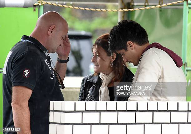 Parents of injured Marussia driver Jules Bianchi of France Philippe Bianchi and Christine speak with his friend Lorenz Leclerc at the Mie General...