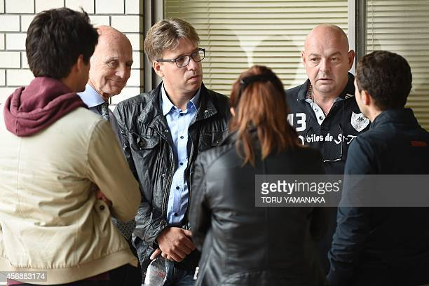 Parents of injured Marussia driver Jules Bianchi of France Philippe Bianchi and Christine speak with his friend Lorenz Leclerc President of the FIA...
