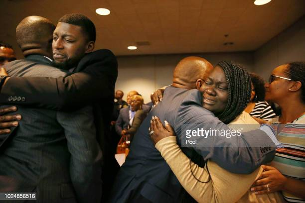 Parents of Jordan Edwards Odell and Charmaine Edwards hug prosecutor George Lewis and family member Reggie Edwards as they react to a guilty of...