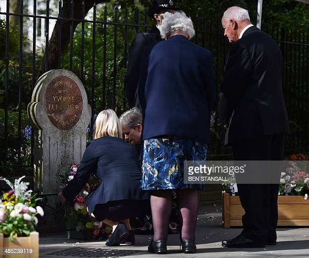 Parents of killed British police officer Yvonne Fletcher Queenie and Tim Fletcher lay a wreath with their daughters Sarah Parson and Heather Allbrook...