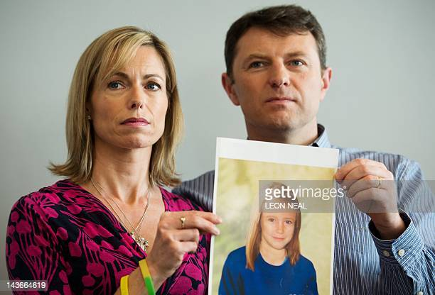 Parents of missing girl Madeleine McCann, Kate and Gerry McCann pose with an artist's impression of how their daughter might look now at the age of...