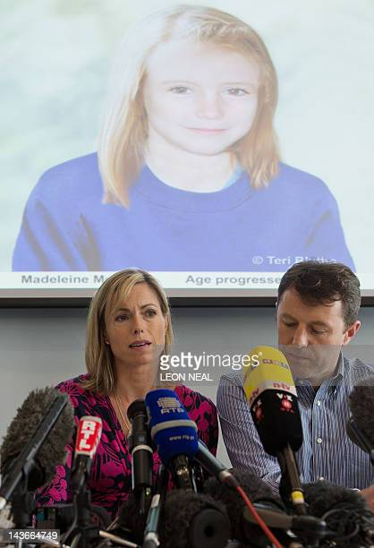 Parents of missing girl Madeleine McCann, Kate and Gerry McCann sit beneath a projection of an artist's impression of how their daughter might look...