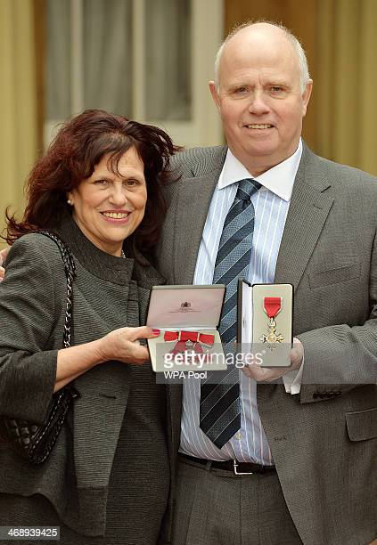 Parents of murdered schoolboy Jimmy Mizen Margaret Mizen and Barry Mizen hold their Member of the Order of the British Empire medals after being...