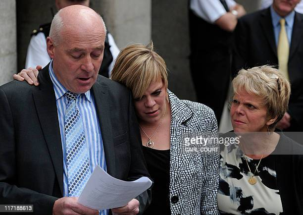 Parents of murdered schoolgirl Amanda Dowler Bob Sally and sister Gemma hug each other as Bob Dowler reads a statement outside the Old Bailey in...