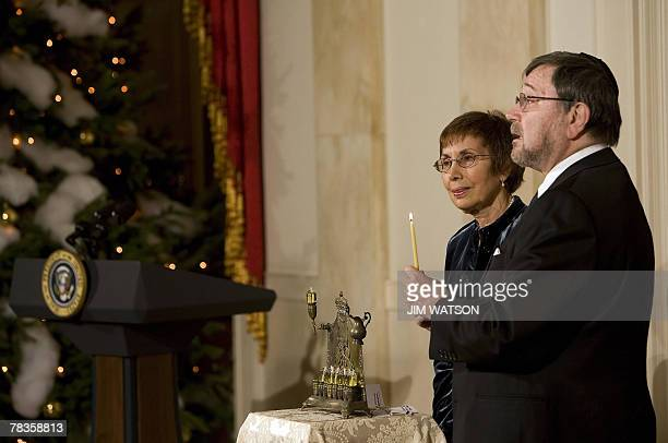 Parents of murdered Wall Street Journal report Daniel Pearl Judea and Ruth light their family Menorah after US President George W Bush made remarks...