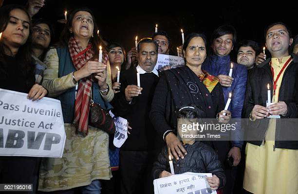 Parents of Nirbhaya alongwith activists during a protest against the release of juvenile convict of the 16 December Gangrape on December 21 2015 in...