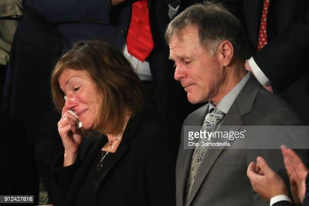 Parents of Otto Warmbier Fred and Cindy Warmbier are acknowledged during the State of the Union address in the chamber of the US House of...