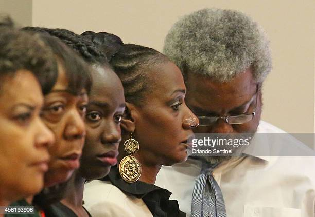 Parents of Robert Champion Jr Pam Champion mother 2nd right and Robert Champion father right listen as the verdict is read Friday Oct 31 2014 after a...