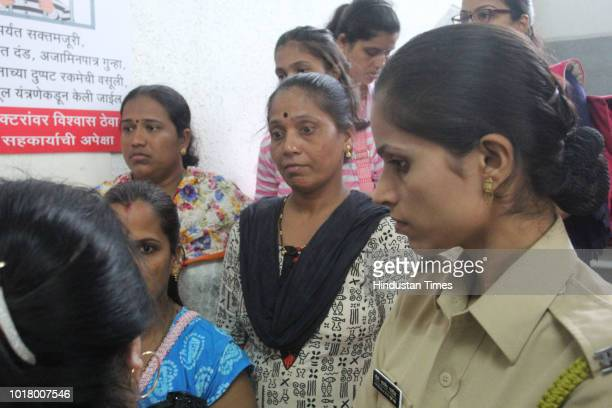 Parents of students at hospital on August 16 2018 in Mumbai India The Class VII students 12 girls and four boys and the staff member ate the dal...
