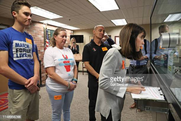 Parents of students at Marjory Stoneman Douglas High School where a shooter killed 17 people in 2018 push petitions for 2020 ban on assault weapons...