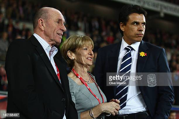 Parents of the late Gary Speed Roger and Carol Speed are seen with Wales manager Chris Coleman during the Gary Speed Memorial International Match...
