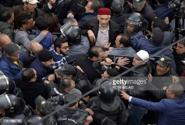 Parents of Tunisian students scuffle with security forces during a demonstration against Lassaad Yacoubi Secretary General of the National Federation...