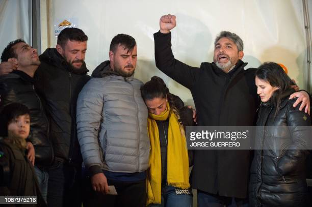Parents of twoyearold Julen Rosello are surrounded by relatives in Totalan southern Spain on January 24 2019 Miners were lowered on a cage to rescue...