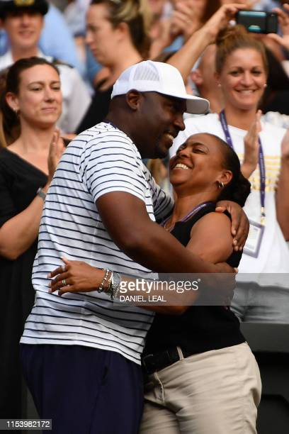 Parents of US player Cori Gauff father Corey and mother Candi celebrate after Cori Gauff beat Slovenia's Polona Hercog during their women's singles...