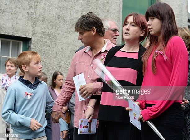 Parents Paul Jones and Coral Jones and family members leave after the funeral of their daughter April Jones at St Peter's Church on September 26 2013...