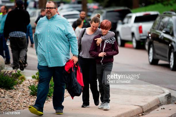 Parents pick up their children from the Recreation Center at Northridge in Highlands Ranch after a shooting at the STEM School Highlands Ranch...