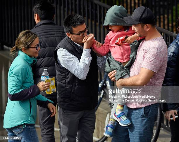 Parents pick up their kids from the Highlands Ranch Recreation Center at Northridge after a shooting at the STEM School on May 7 in Highlands Ranch,...