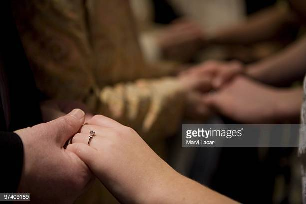 Parents place rings on their sons and daughters who participated in the purity ring ceremony on February 13 2008 at the Full Life Assembly of God in...
