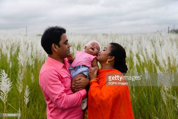 Parents play with their child in Dia Bari. Dia Bari is the most popular attractive destination for tourists in Dhaka. It is a very nice green place...