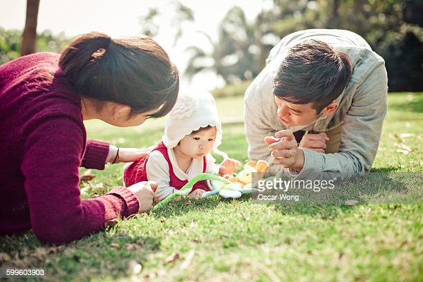 Parents playing with baby girl outdoor