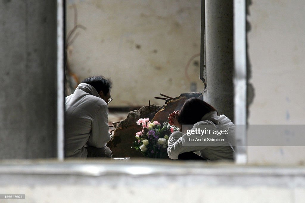 Parents pray for victims at Okawa Elementary School where 70 out of 108 pupils were killed by the tsunami triggered by the strong earthquake on March 11, 2012 in Ishinomaki, Miyagi, Japan. Japan marks the first anniversary of the Great East Japan Earthquake.