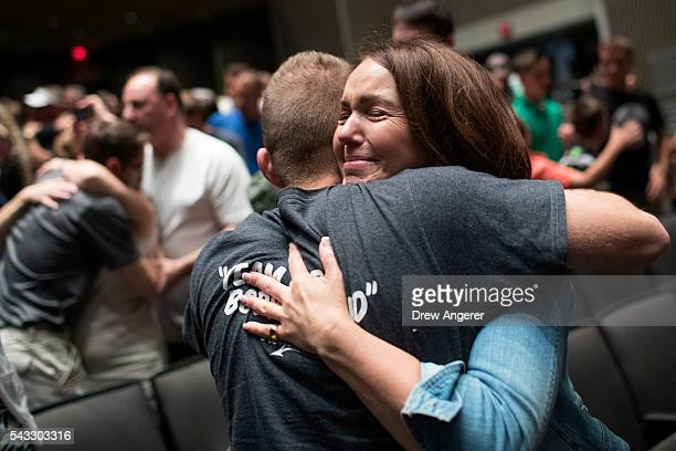 Parents say goodbye to their children as the cadet candidates begin the inprocessing procedures during Reception Day at the United States Military...