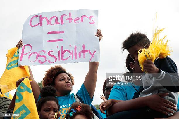 Parents, schoolchildren and education activists rally during an event supporting public charter schools and protesting New York's racial achievement...