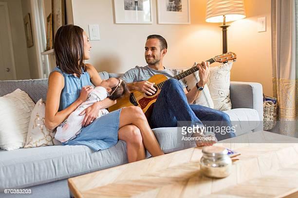Parents serenade baby girl, lovingly