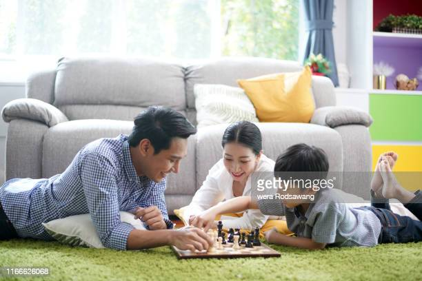 parents spending time to playing with their kid - commercial activity stock pictures, royalty-free photos & images