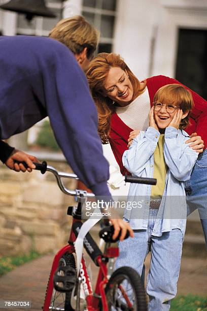Parents surprising son with bicycle