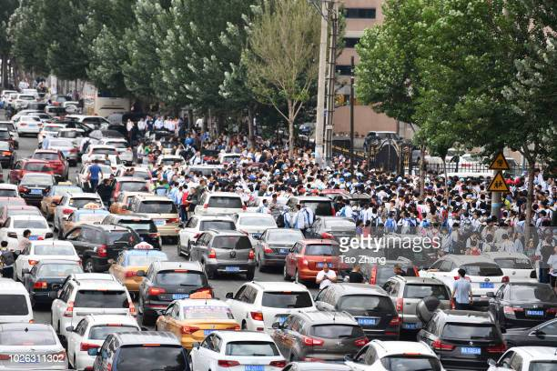 Parents take children to the school during an opening ceremony on the school opening day cause traffic jam at Hongqiao School on September 3 2018 in...