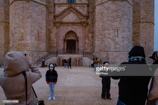 Parents taking pictures of their children at the Castel del Monte in Andria on January 17, 2021. In Puglia today the Orange Zone began according to...