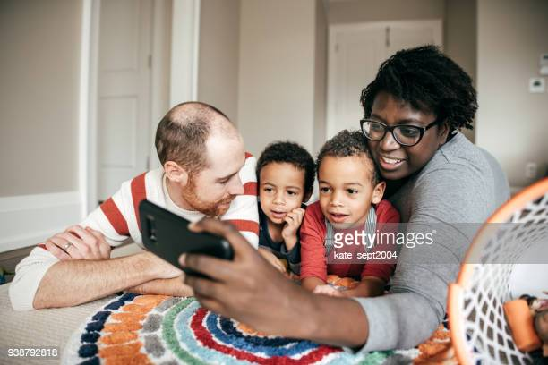 Parents taking selfie with kids at home