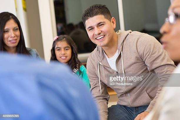 Parents talking during meeting with students at elementary school