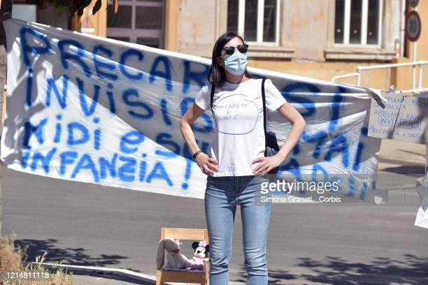 Parents, teachers and children protest near the Ministry of Education on May 23, 2020 in Rome, Italy. The protest is to demand the reopening of...