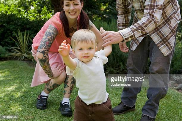 Parents teaching son to walk