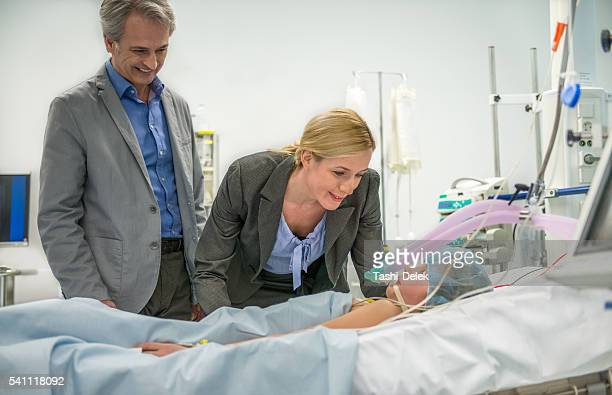Parents Visit Daughter In Hospital
