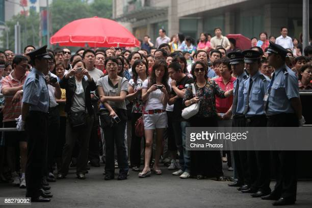 Parents wait outside an exam center while their children sit the National College Entrance Examination on June 7 2009 in Beijing China About 102...