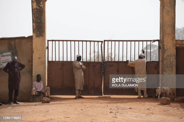 Parents wait outside the Government Science Secondary school in Kankara, in northwestern Katsina State, Nigeria on December 16, 2020. - Boko Haram on...