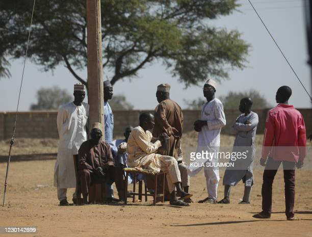 Parents wait outside the Government Science where gunmen abducted students in Kankara, in northwestern Katsina state, Nigeria December 15, 2020. -...