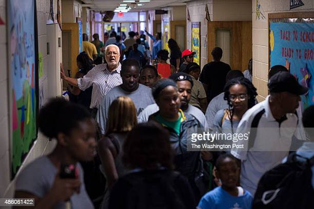 Parents walk through the hallways to pick up their children at Lake Forest Elementary Charter School in New Orleans LA on Friday August 21 2015 New...