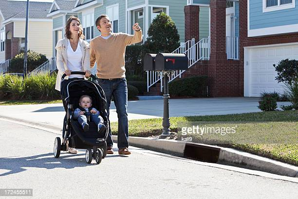 Parents walking with baby