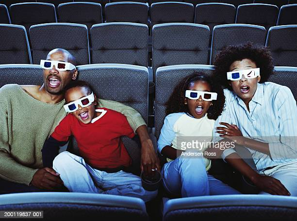 parents watching 3-d movie with son and daughter (6-8) - 3d mom son stock photos and pictures