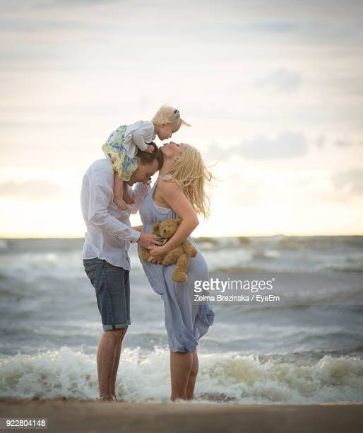Parents With Baby Girl At Beach