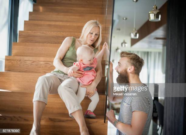 parents with baby girl (12-23 months) playing indoors - 12 23 months stock pictures, royalty-free photos & images