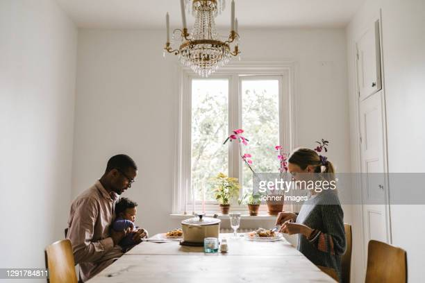 parents with baby having meal - paternity leave stock pictures, royalty-free photos & images